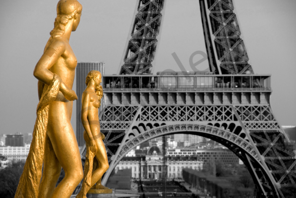 Fine art photograph of golden female statues with Eiffel Tower in back