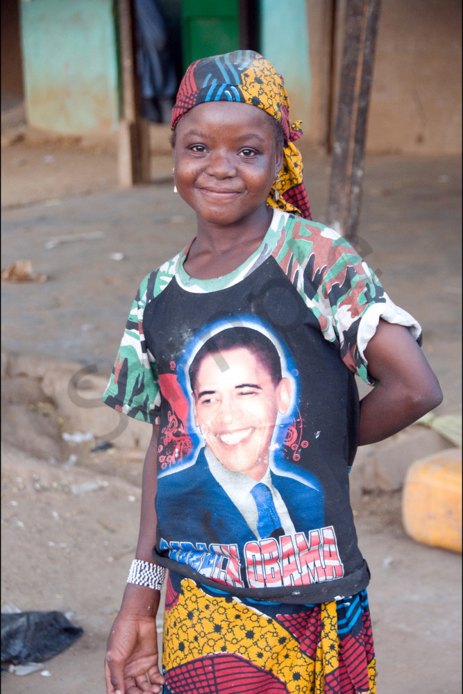 Girl with traditional African skirt and bandana wearing Obama tee-shirt, fine art photograph
