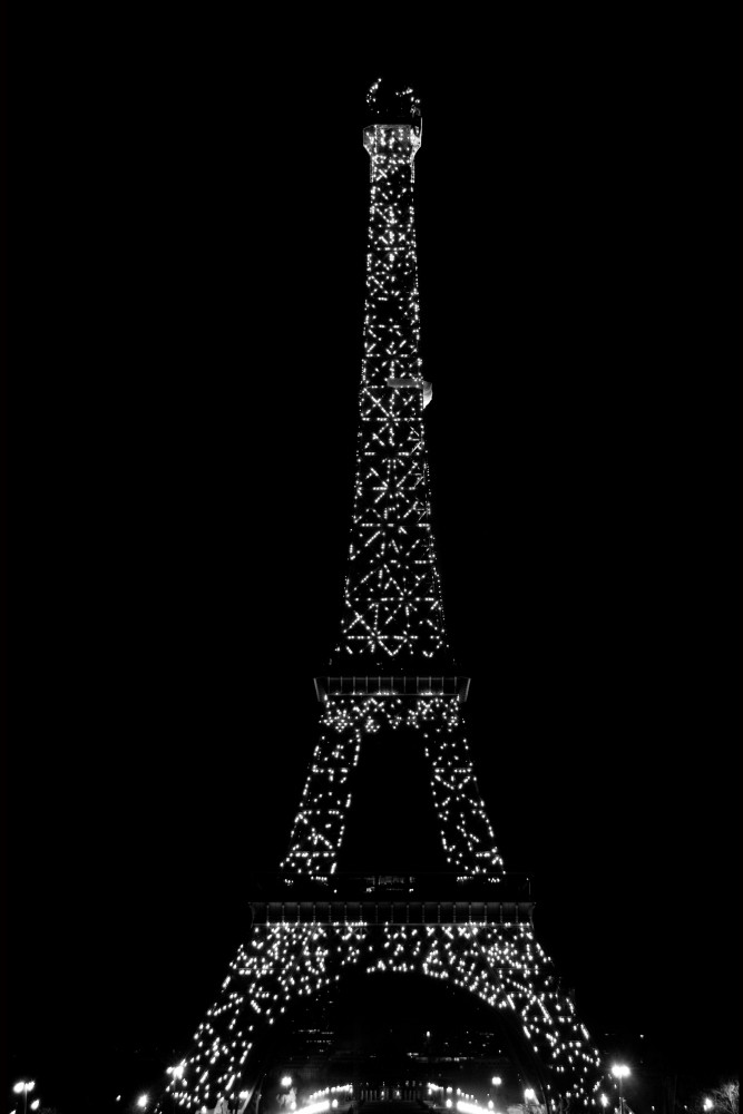 Eiffel tower at night with white lights, , black and white art photograph