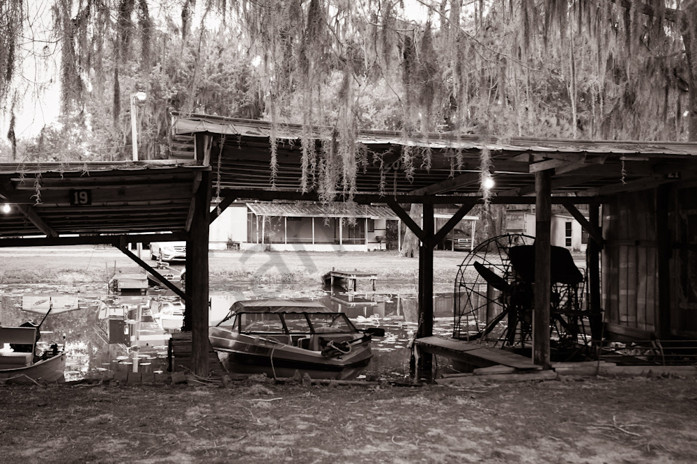 Sepia photograph of boats docked on a bayou for sale as fine art by Sage & Balm