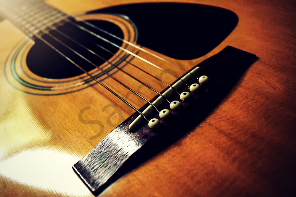 Macro musical instrument conceptual & abstract photograph of an acoustic guitar's bridge and strings, for sale as fine art by Sage & Balm