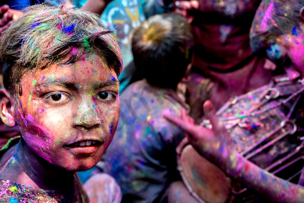 Portrait of boy with color on his face during the Holi celebrations, art photograph