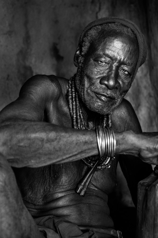 Himba chief in hut in black and white portrait