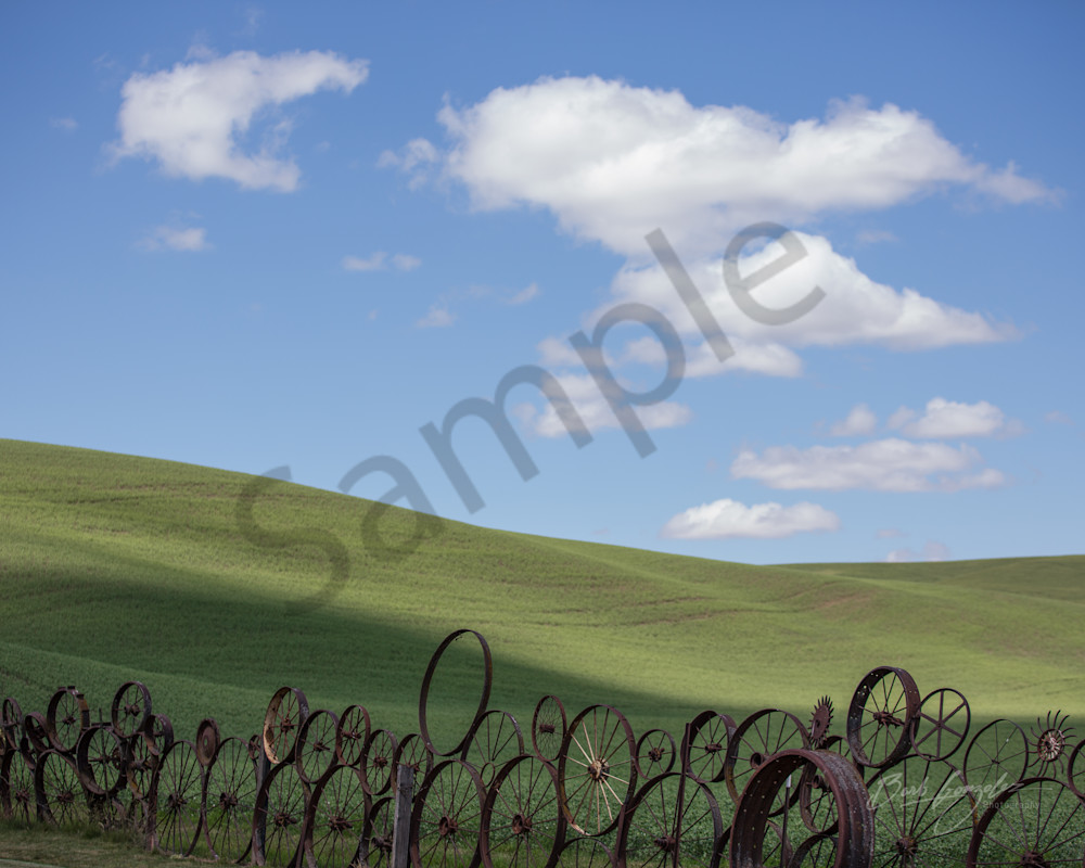 Wheel Fence and Clouds Photo for Sale by Barb Gonzalez Photography