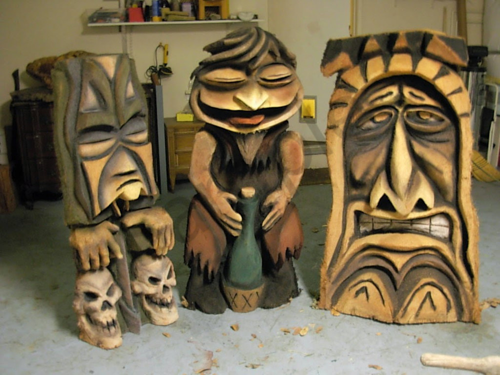 Three amigos chainsaw carvings by marc wolf creeky tikki in san luis