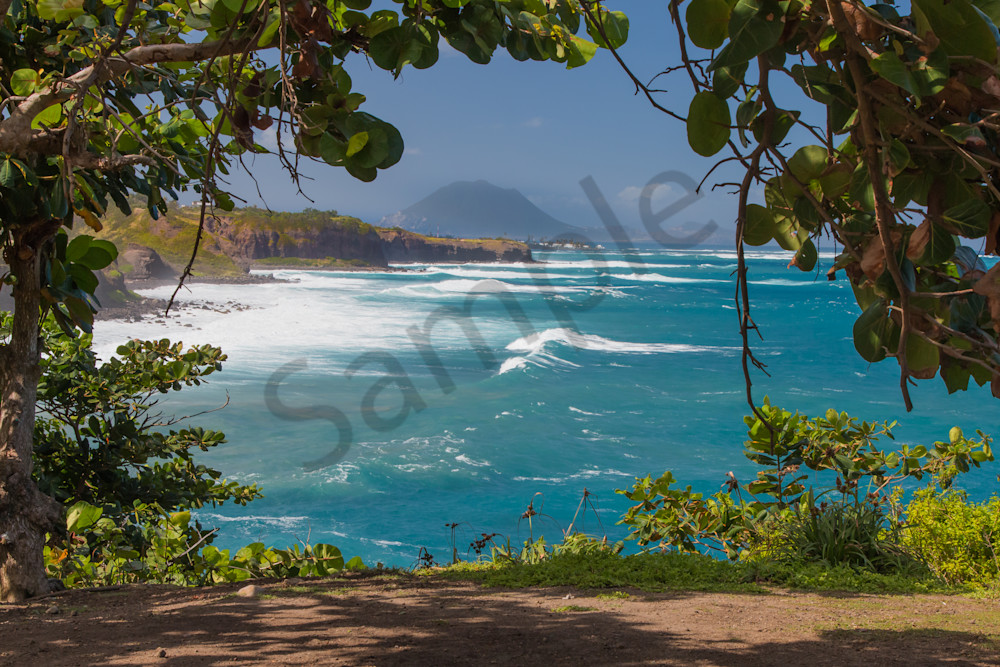 Beach on St. Kitts with ocean waves roaring.