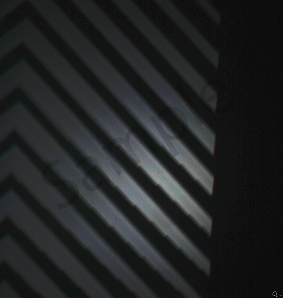 Dark metallic subtle photograph of a light projection reminiscent of a NIN album cover prints for sale by Michael Toole