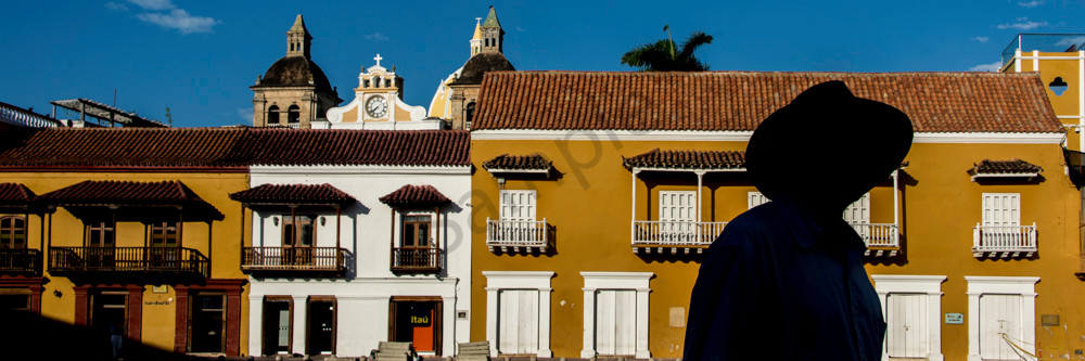 Panorama of Cartagena colonial buildings with silhouetted man