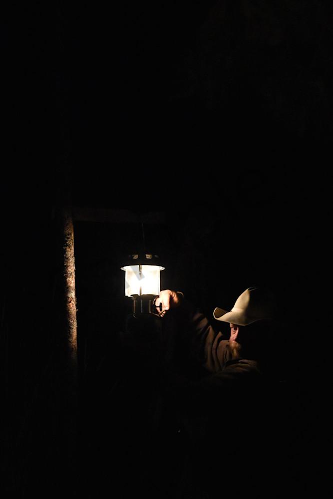 Photograph of a man lighting a lantern for sale as Fine Art
