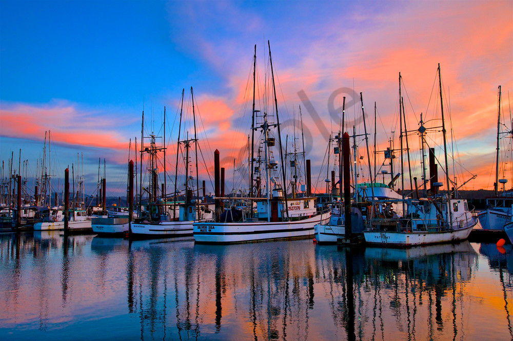 Picture of fishing boats at sunset in Coos Bay, Oregon.  Great wall decor for boat lovers.