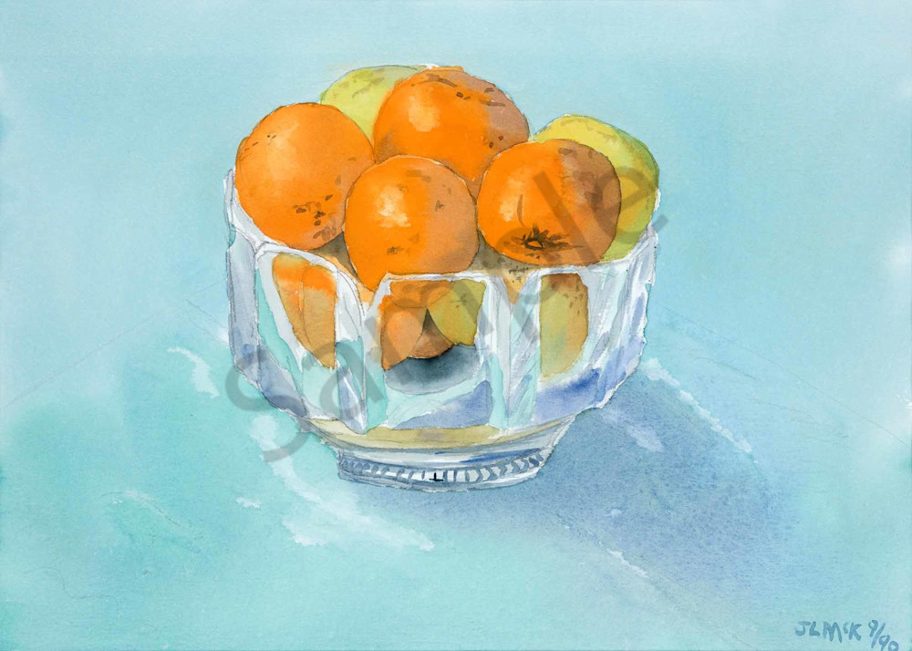 Oranges and lemons in a crystal bowl.