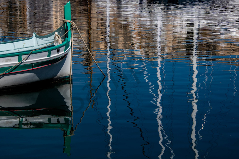 Maltese boat with ripple reflections