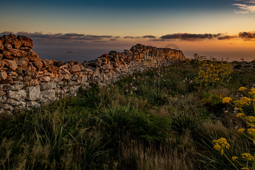 Stone wall ocean sunset