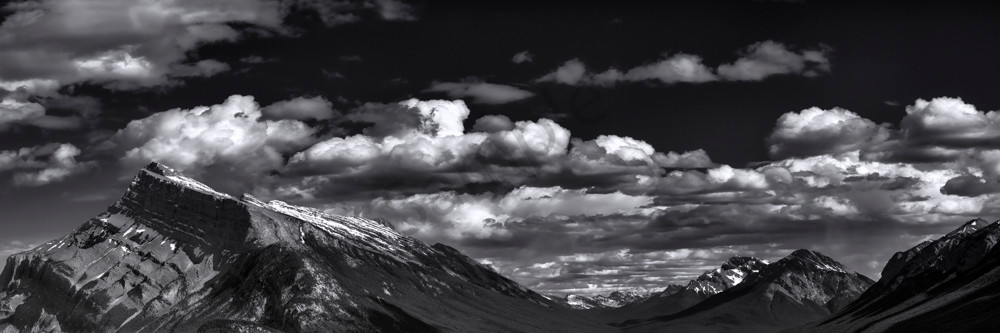 Huge clouds drift above Mt. Rundle and the Spary Valley in Banff National Park. Canadian Rockies|