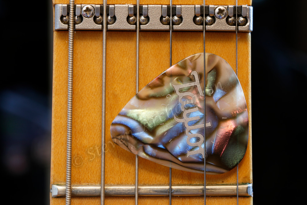 Macro photography of guitar and pick by fine art photographer Steven Archdeacon.