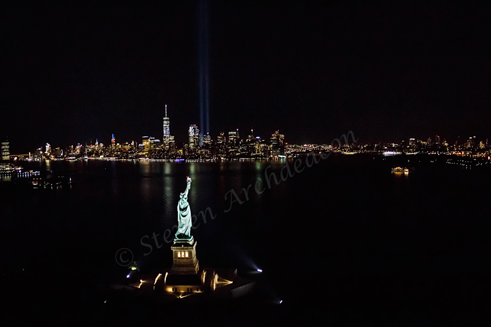 Statue of Liberty photograph from helicopter with World Trade Center & Tribute Lights by Steven Archdeacon.