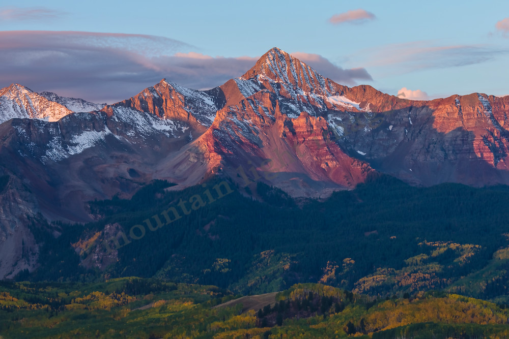 mountain light images fall sunrise on mt wilson near telluride colorado with clouds blue sky and yellow color