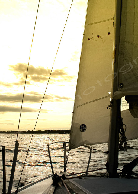 Sailing into a yellow sunset in Salem Harbor.