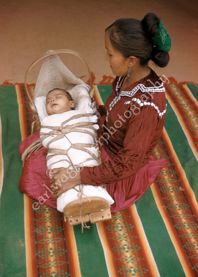 Woman on Blanket with Child in Cradleboard