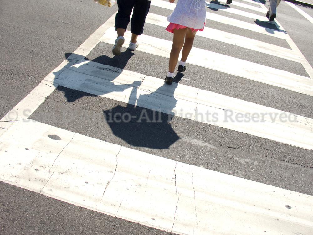 Pedestrians And Shadows At A Crosswalk. Washington, DC