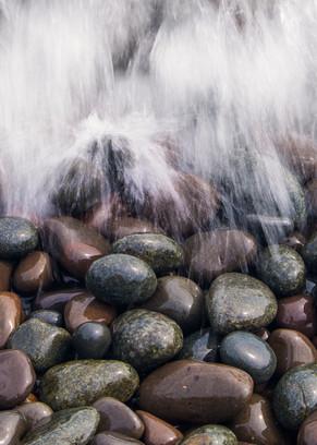Waves crashing into rocks along Lake Superior