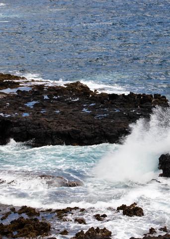 Shop waves crashing on rocks.