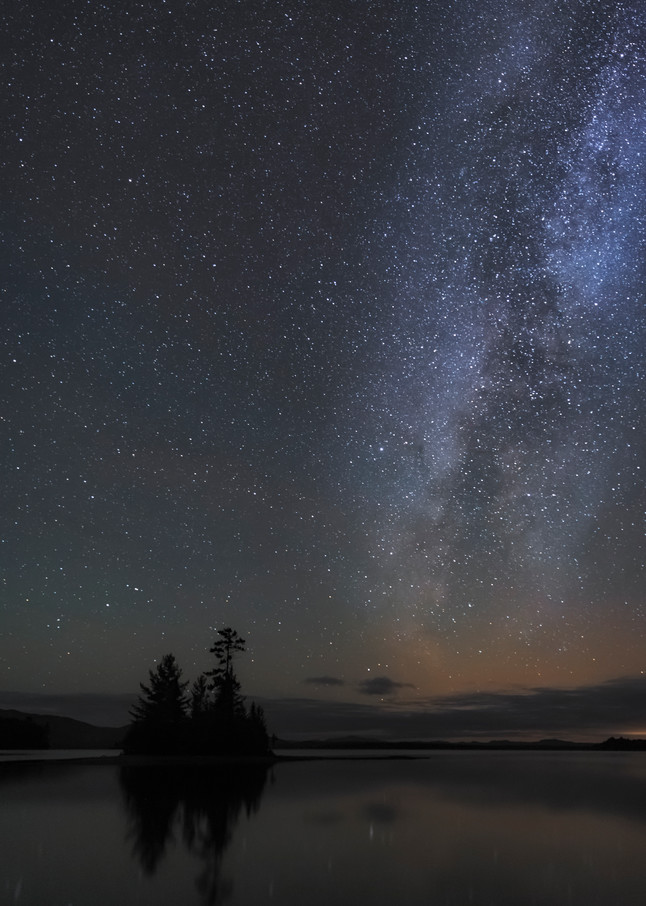 Aurora borealis glowing over Moosehead Lake.