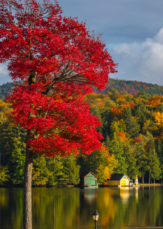 Yellow Boathouse Fall Vertical on Old Forge Ny pond.
