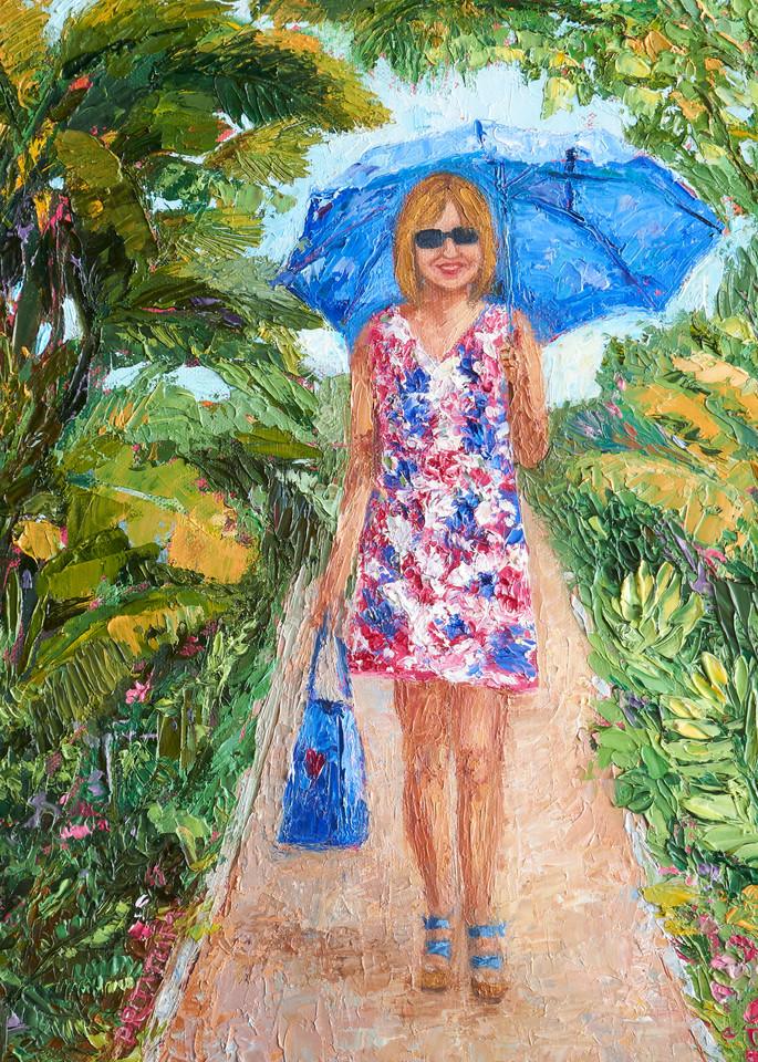Girl walking under blue umbrella