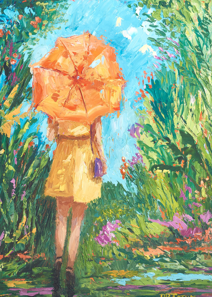 Girl under orange umbrella, spring rain