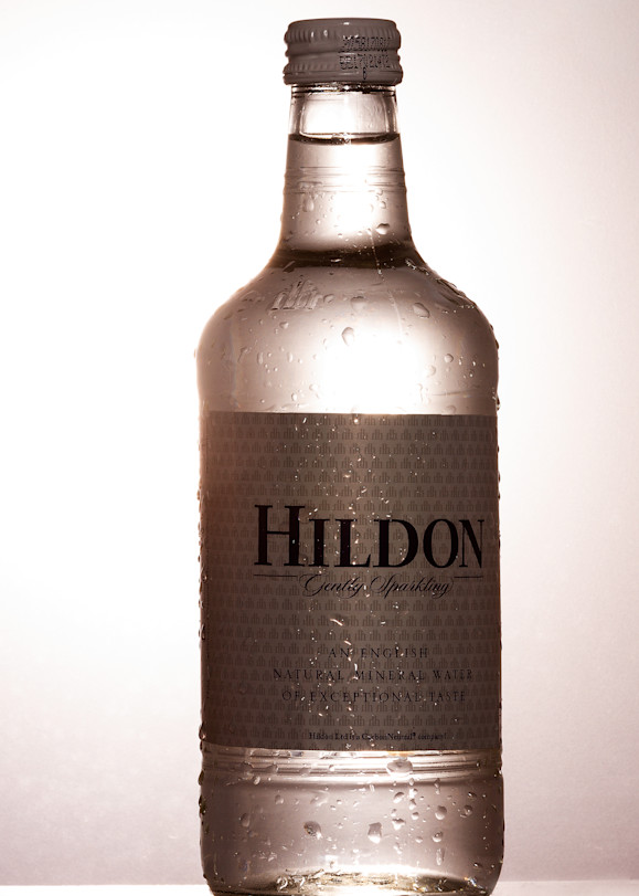 A Fine Art Photograph of Hildon Bottle Reflection on Black Plexi by Michael Pucciarelli
