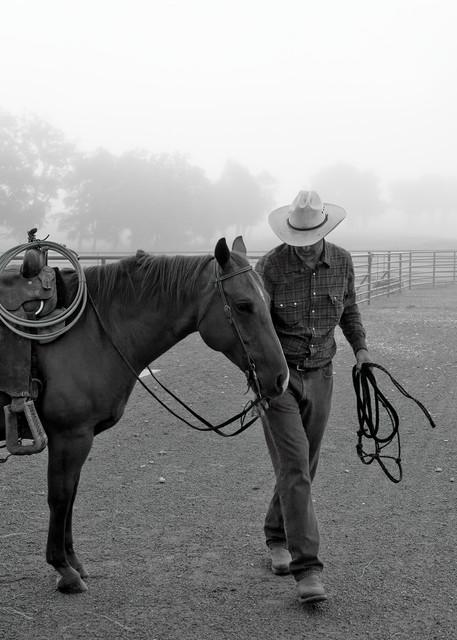 Cowboy and horse in morning fog, 44 Farms, near Cameron, Texas