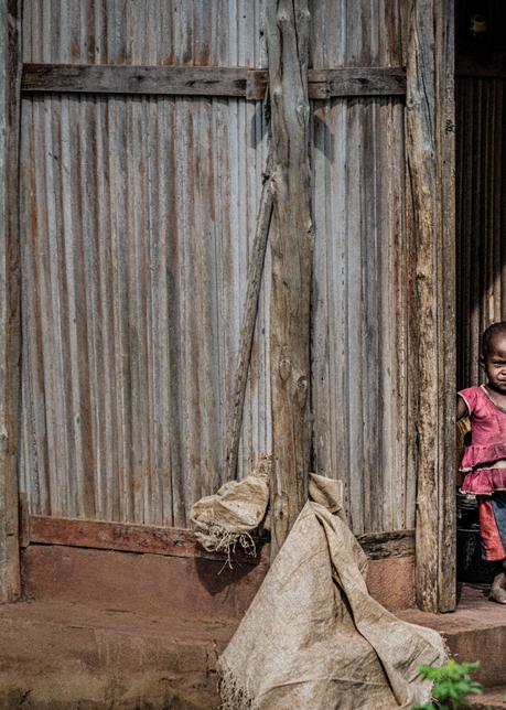 Girl in a doorway, Nosy Be, Madagascar, 2019.