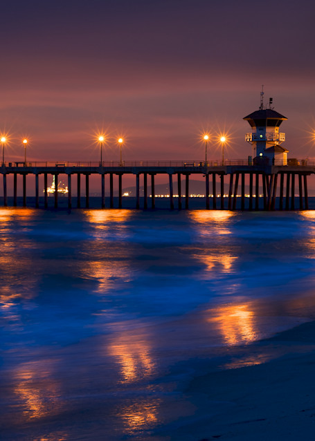 photo of the huntington beach pier with reflected lights on the water