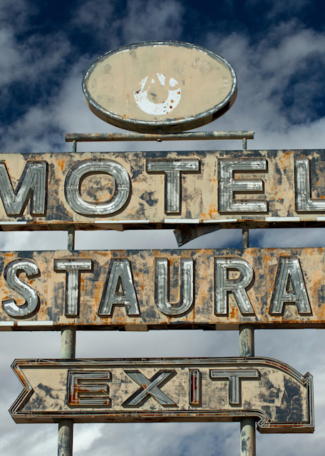 dilapidated sign by the side on an arizona highway