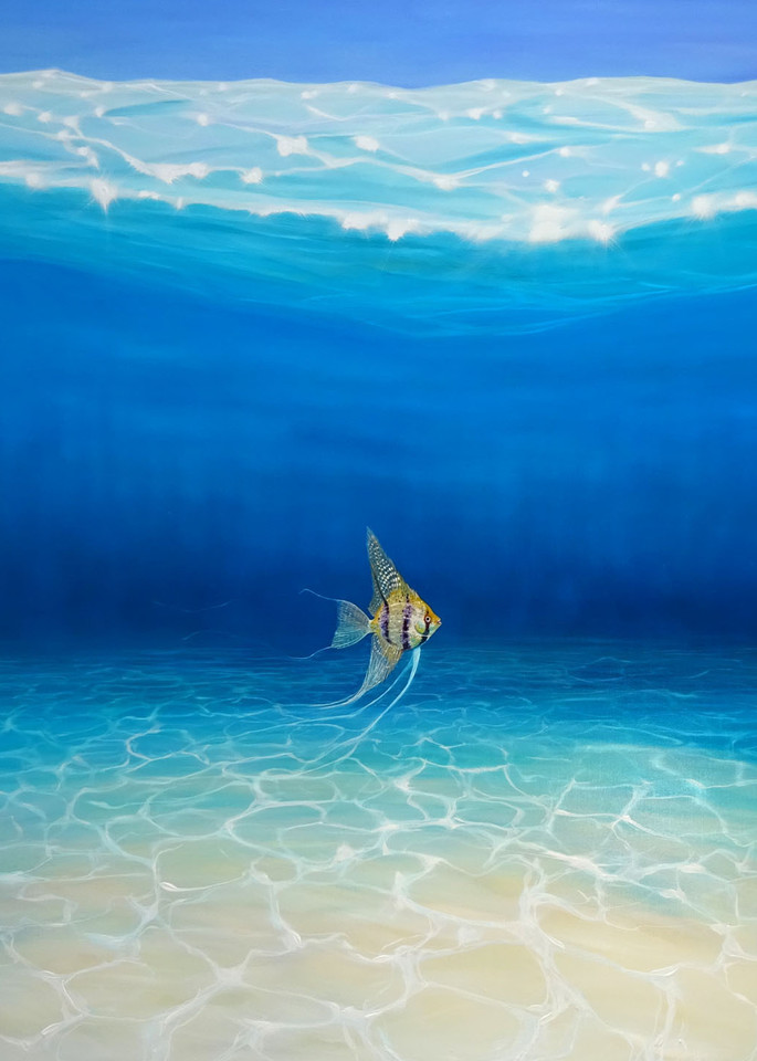 A print of a single fish in a blue underwater seascape  with sparkling sea and sandy sea bed
