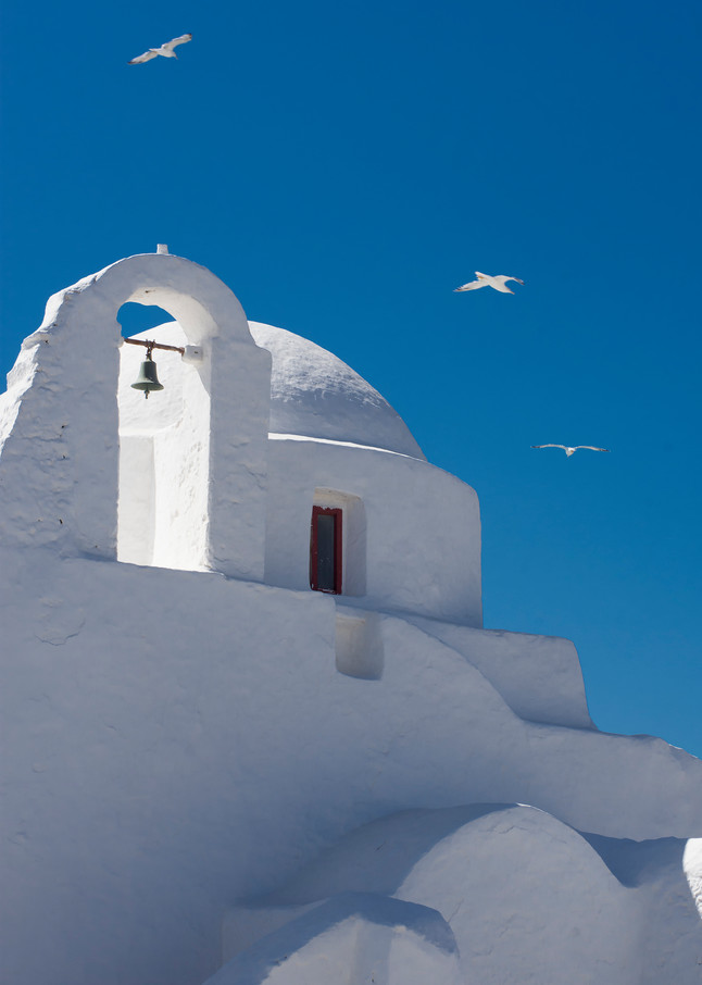 White church with dome ion Mykonos, Greece
