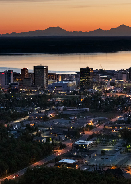 Spring landscape aerial photo of Anchorage, Alaska  skyline cityscape at dawn/sunrise with Cook Inlet and Alaska Range and Denali (aka Mt. Mckinley) om background.    Photo by Jeff Schultz/SchultzPhoto.com  (C) 2017  ALL RIGHTS RESERVED