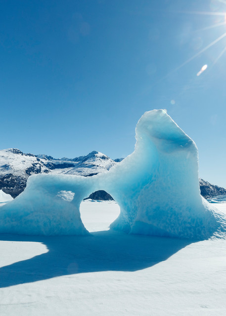 Spring landscape of ice bergs frozen into Inner Lake George, Colony Glacier.    Chugach Mountains.  Alaska   Sunny day-- blue sky  Photo by Jeff Schultz/  (C) 2020  ALL RIGHTS RESERVED