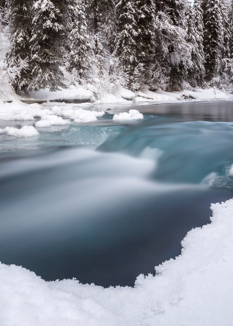 Winter landscape of slow exposure of partially frozen Granite Creek and snow covered trees in the Turnagain Pass area of Kenai Penninsula Alaska  December 2015  Photo (C) Jeff Schultz/SchultzPhoto.com