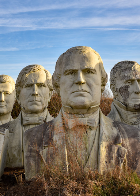 Grouping of presidential statues in ruins