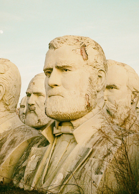 Film photograph of presidential statues at the Ruins of Presidents Park in Virginia.