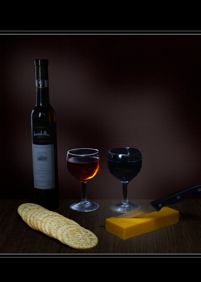 A Fine Art  Photograph of Cheese and Crackers by Michael Pucciarelli