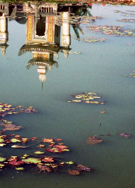 Reflection of temple on the city outskirts of Ha Long Bay, Vietnam