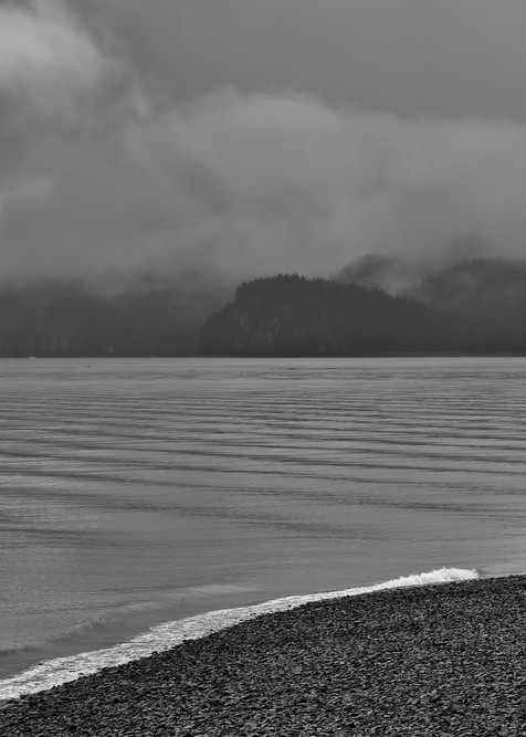 Two fisherman fishing for salmon in Resurrection Bay along Lowell Point in Seward in morning fog on the Kenai Peninsula in Southcentral Alaska. Summer.