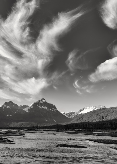 Cirrus clouds over the Chugach Mountains and the Lowe River at dawn in Southcentral Alaska. Summer.