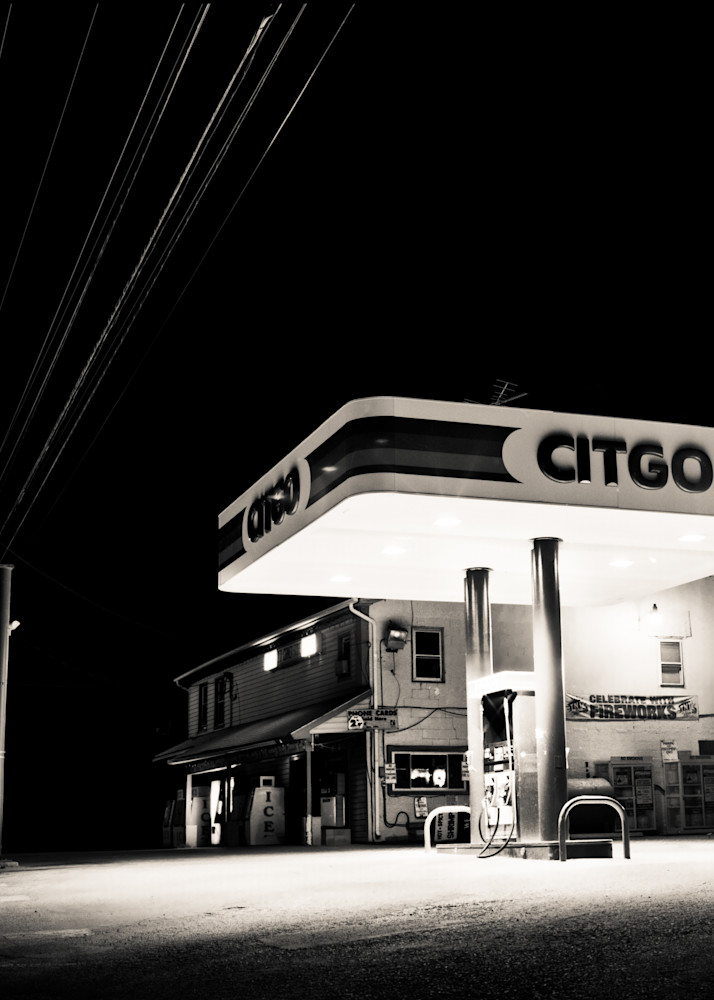 Night photograph of a lonly gas station in rural town America.