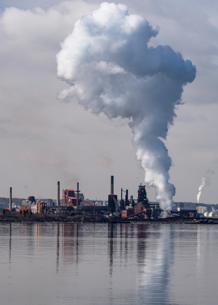 Steam clouds rising above Hamilton's industrial waterfront