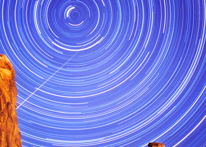 Delicate Arch with star trails also includes a meteor.