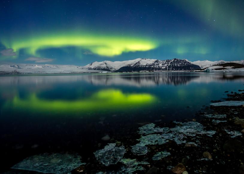 Iceland northern lights reflected in Jökulsárlón glacier lagoon.